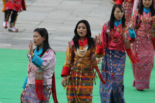 Women dancing in their traditional dress called Kira    during Tsechu (Festival)