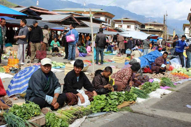 Vendors selling fresh vegetables in weekend market in Paro (Bhutan)